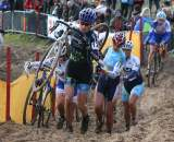 CXM's Christine Vardaros leads a group through the sand. ?Bart Hazen