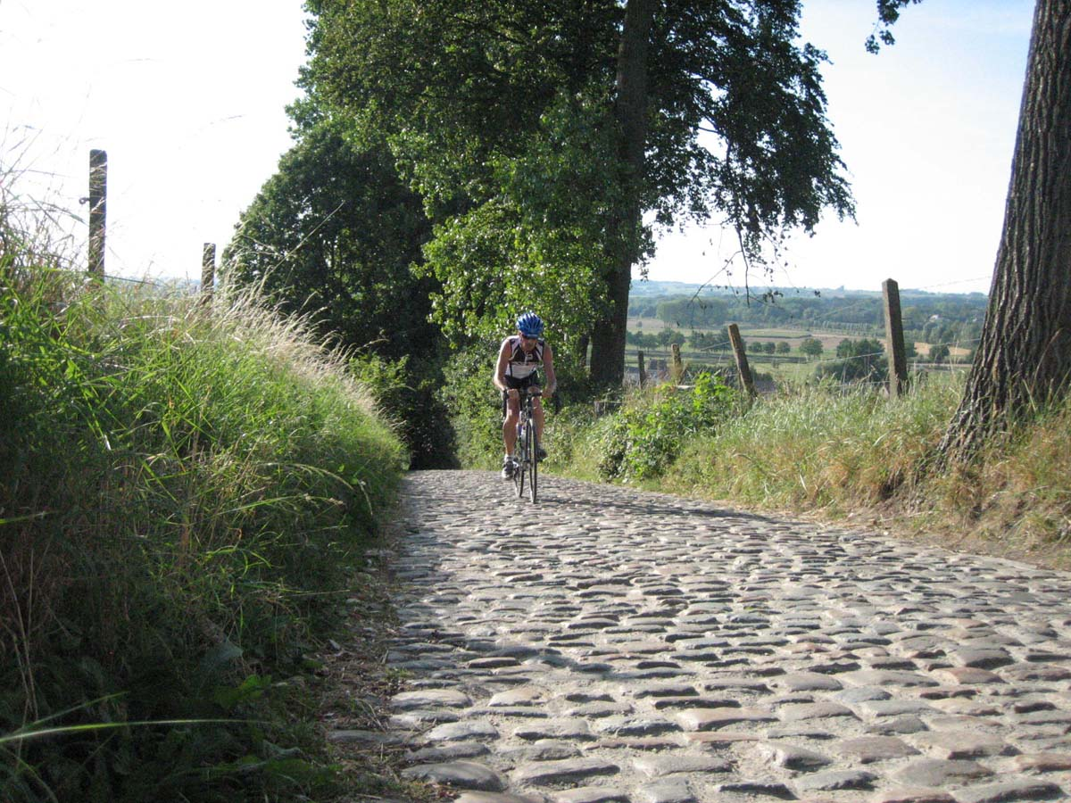 Jonas climbing the Koppenberg. The descent is on his left in the grass. by Christine Vardaros