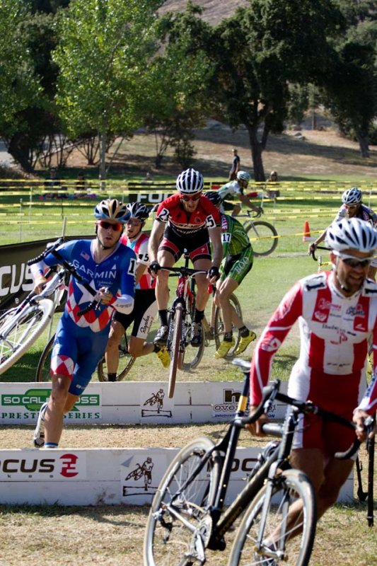 Parbo takes the front while Sid Taberlay bunnyhops the barriers © Mark Colton