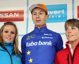 GvA overall leader Lars van der Haar flanked by podium girls Sarah van der Elst (L) and Lien Lauwers (R).