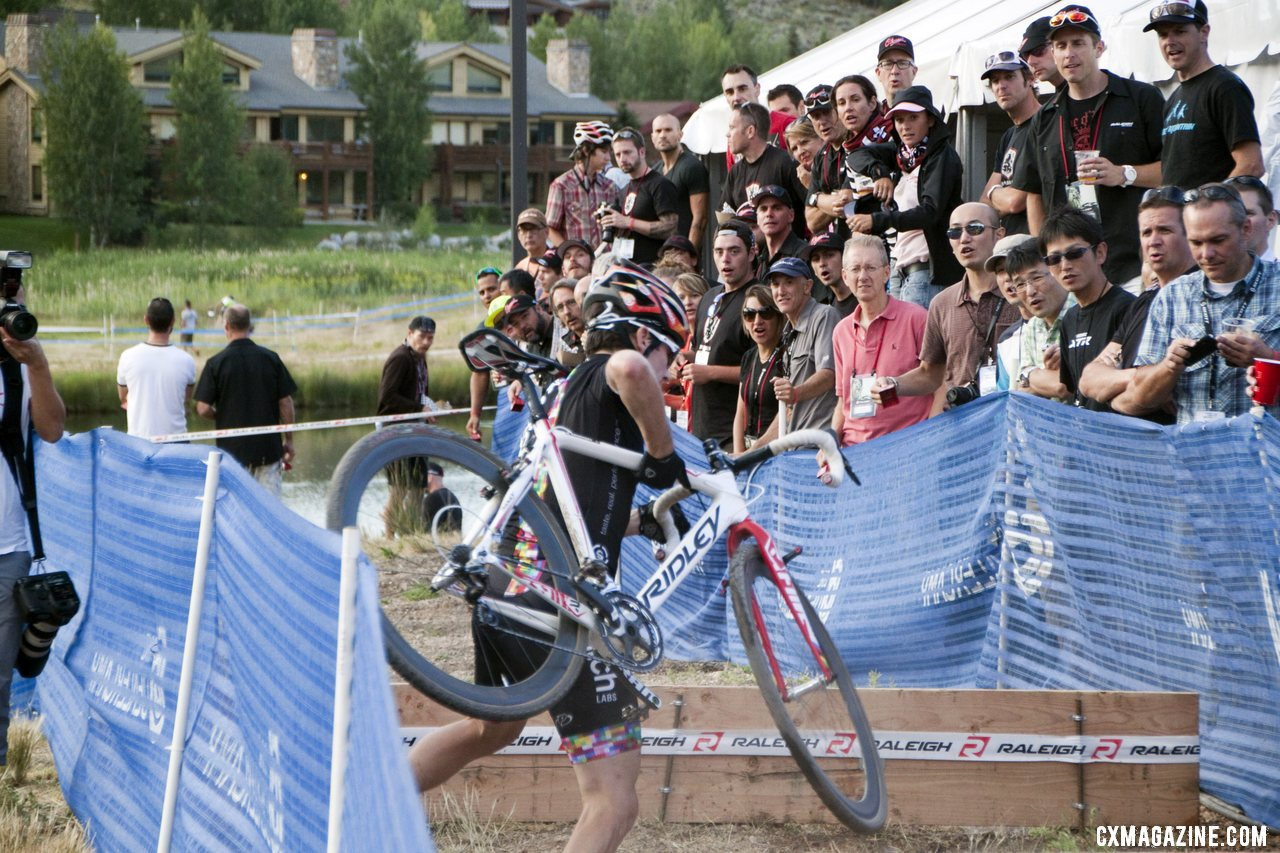 Angling into the barriers. 2012 Raleigh Midsummer Night Cyclocross Race. @Cyclocross Magazine