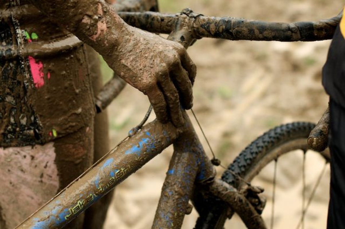 Rider and bike receive the mud treatment © Matthew J. Clark/www.strfilms.com
