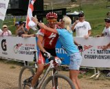 Wells' wife offers hearty congrats at the finish line © Amy Dykema