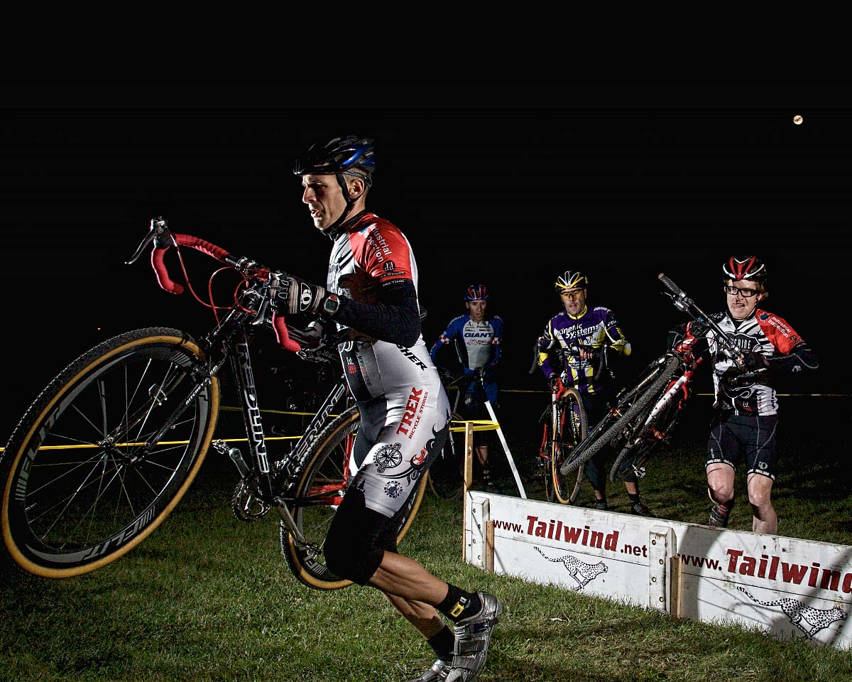 Master Racers navigate the the barriers under the moon in the Munson Park Night-Cross. ? Andrea Tucker 2009/www.tuckerbikes.com