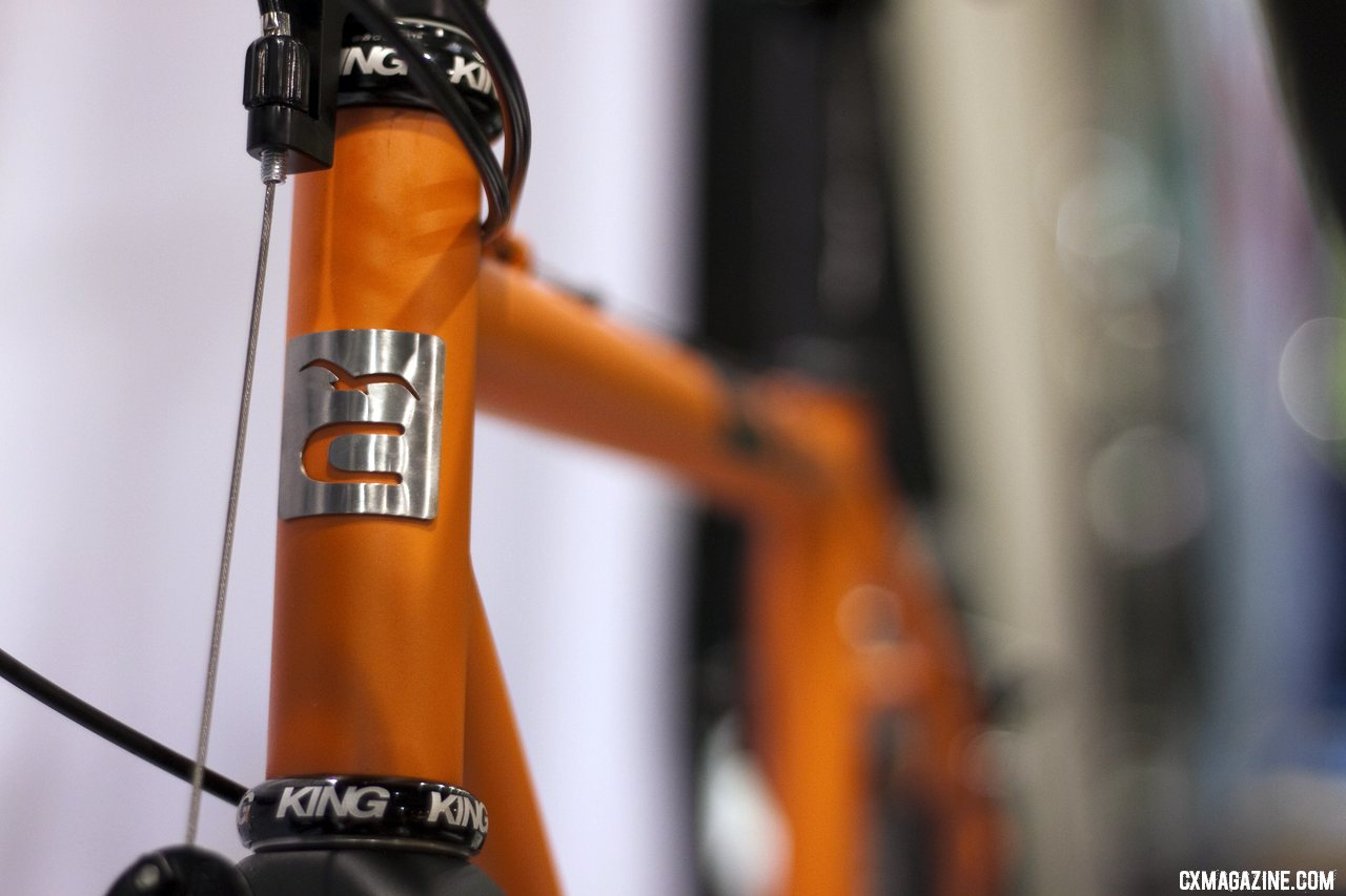 Caletti\'s TIG-welded steel cyclocross machine\'s head tube and head badge. ©Cyclocross Magazine