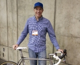 "Jon Cariveau poses with his ""Best Cyclocross Bike"" winning Moots Titanium PsychloX RSL cyclocross bike, NAHBS 2012. ©Cyclocross Magazine"