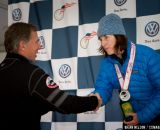 Julie Oneil receiving the silver medal from USAC President Steve Johnson.  © Brian Nelson