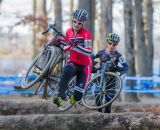 Emma White (Cyclocrossworld.com) bounding over the logs ahead of Arley Kemmerer (C3 Twenty20 Cycling). © Todd Prekaski