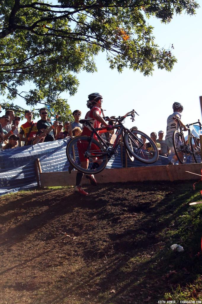 A rider just barely clears the barrier. © Cyclocross Magazine