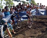 The men's pack dismounts ahead of the barriers. © Cyclocross Magazine