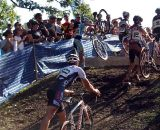 A rider has difficulty getting his bike over the barrier. © Cyclocross Magazine
