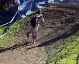 A lone rider dismounts ahead of the barrier. © Cyclocross Magazine