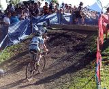 Two riders pursue a third through the barriers. © Cyclocross Magazine