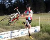 McDonald hits the barrier with speed. Raleigh Midsummer Night's cyclocross race. © Cyclocross Magazine