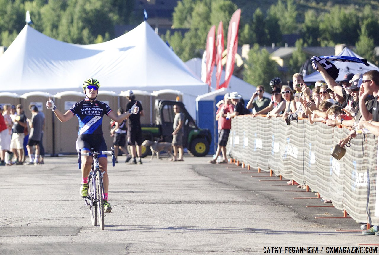 Mani winning in front her sponsors and fans. 2013 Raleigh Midsummer Night\'s cyclocross race. © Cathy Fegan-Kim