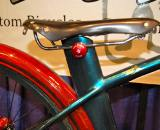 The fenders and chain guard on Anderson?s bike were all hand made from laminated wood. The rear fender was cut out of an 8 lb. wood blank that had been water soaked and bent to the appropriate curve in a custom jig. As a finishing touch, the tops of the fenders were inlayed with mother-of-pearl. ? Dave Lawson