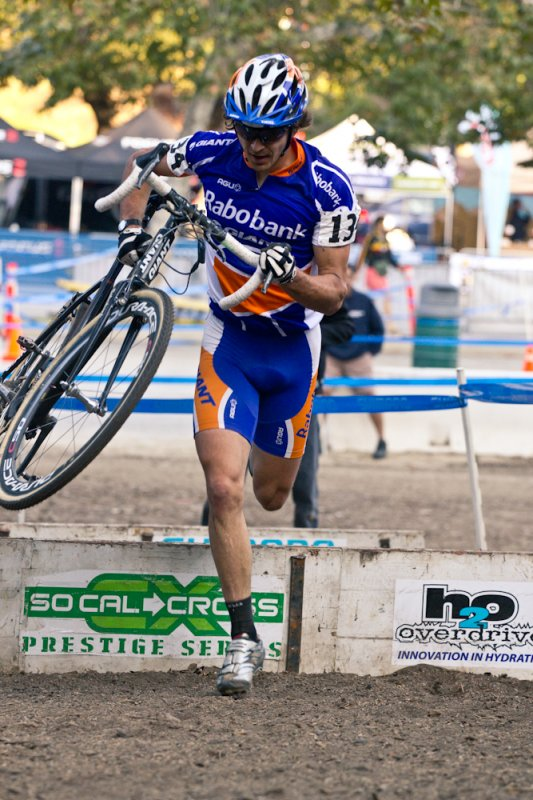 Adam Craig attacks the barriers. © M. Rock