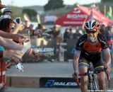 Paxson grabs dollar bills at the Raleigh cyclocross race at Sea Otter. © Cyclocross Magazine