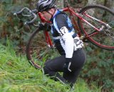 A rider is forced to shoulder his bike up one of the steeper sections © Janet Hill