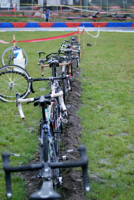 The drainage ditch doubled as a bike stand in the pits ©Kenton Berg