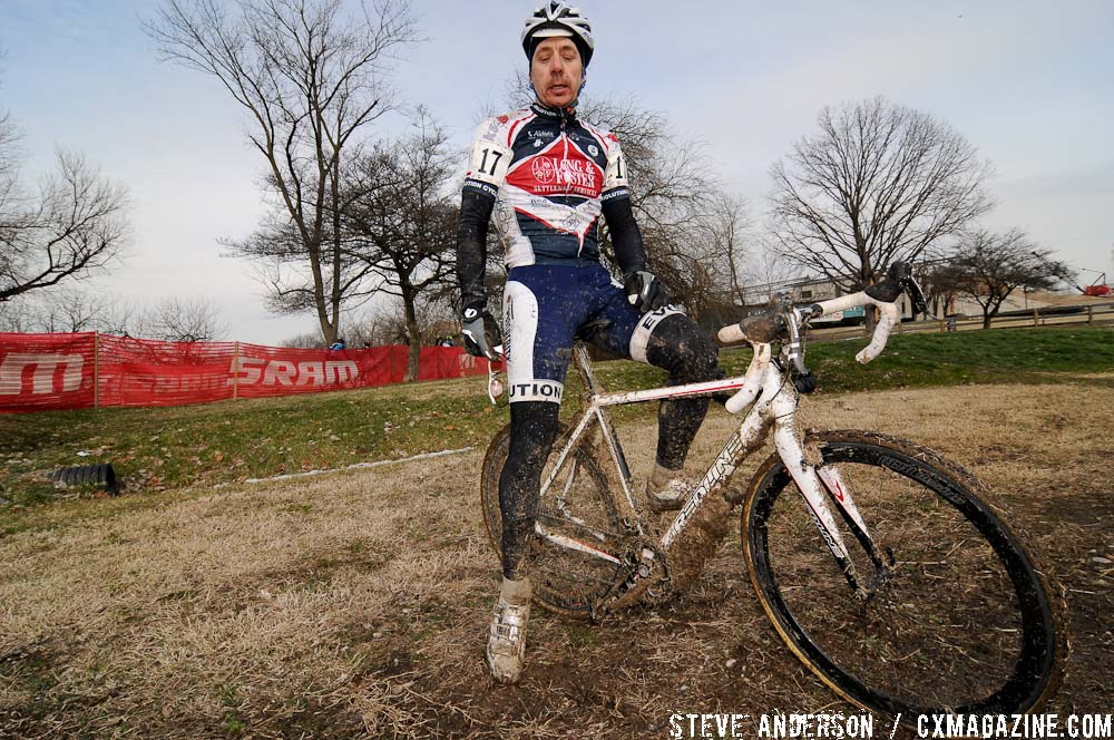 Ron Huebner contemplating how much faster he could have gone without 10 pounds of mud on the frame. ©Steve Anderson