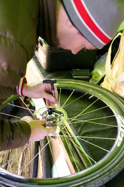 Cannondale-Cyclocrossworld.com Matt Roy tightens the disc rotors on Johnson\'s Zipp 303s ©Whit Bazemore