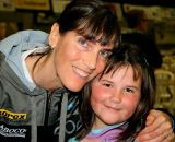 christine-with-one-of-her-youngest-fans-alison-daughter-of-baboco-team-mgr-by-dirk-bruylant