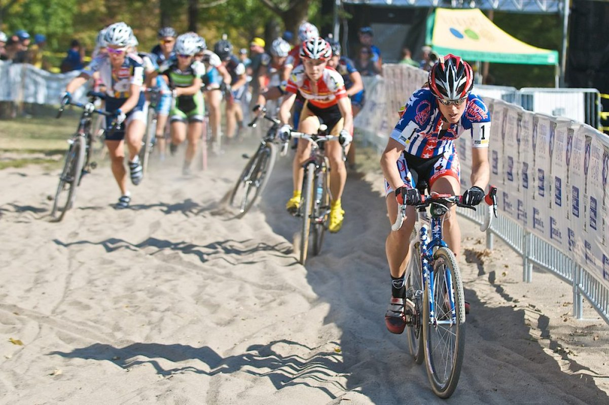 The winning move of the Women's UCI race took place less than two minutes after the start as Katie Compton gapped the field on their first trip through the sand barrier © 2010 Jeffrey B. Jakucyk
