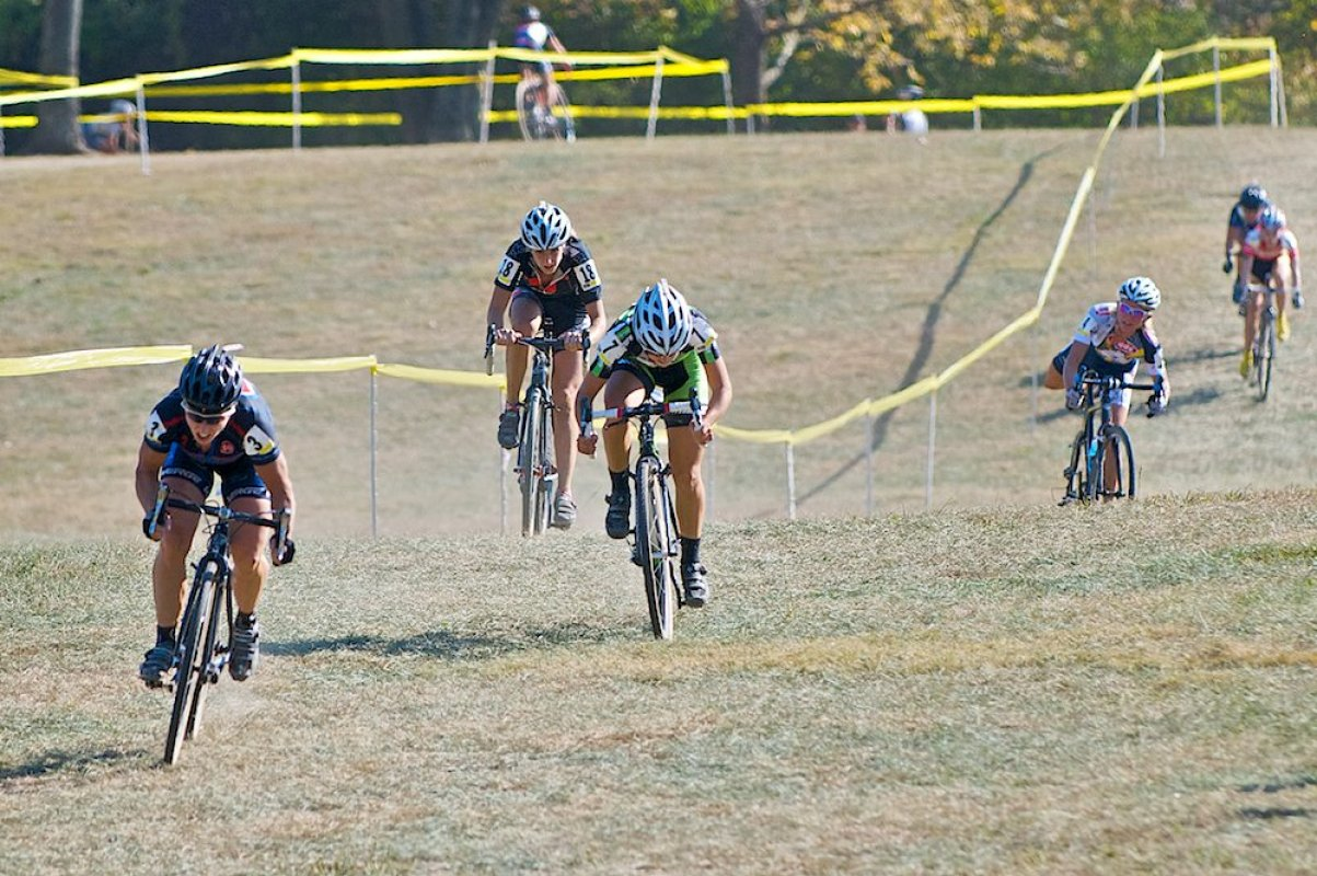 Laura Van Gilder powers away from Katie Antonneau and Ashley James in the sprint for second, while Sue Butler dismounts with a jammed drivetrain © 2010 Jeffrey B. Jakucyk