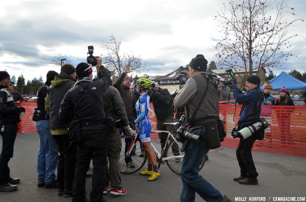 A crew presents a beaming Nash with a birthday cake. © Cyclocross Magazine