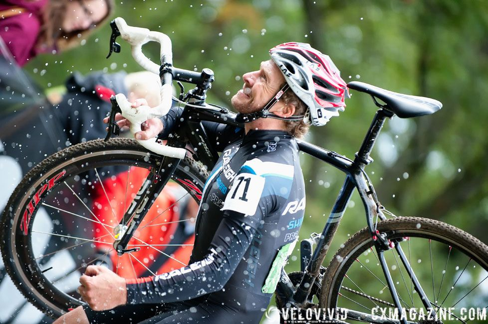 after taking a small sip from a beer hand-up, the crowd went wild and Johnny threw the beer down with great show where beer literally \'exploded\' out of the can. © VeloVivid Photography
