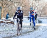 Diane Ostenso (Trek Midwest Team) and Jane Geisse (Spin) in the frigid first race of the day.  ©Brian Nelson