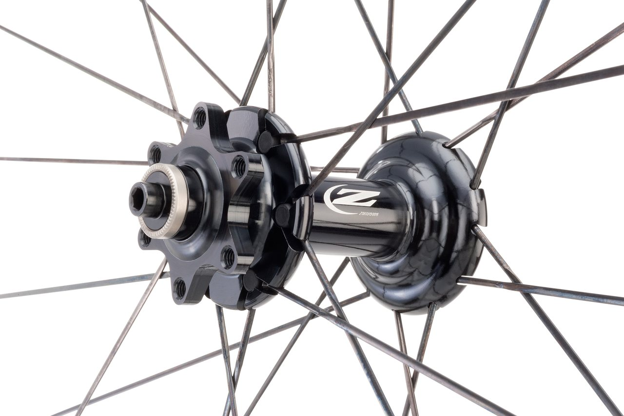 Zipp adds six more spokes to the front wheel to offset braking stresses. photo:Zipp