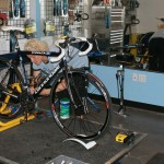 Coach Kristi Berg setting up the bike for the spin scan test. by Kenton Berg.