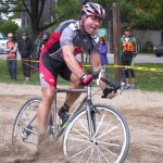 Papa John Schnatter surfs the sand during the Harbin Park International.  Photo by Todd Dittrich