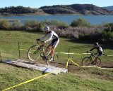 One rider attempts to hop the barrier while another dismounts @ Amanda Schaper
