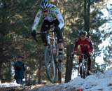 """Rider airs the """"snow drop"""" while Bart Bowen chases © Wade Miller"""