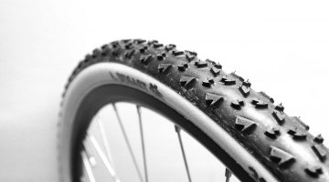 Cyclocross tires, like this Dugast, are narrow with dirt tread