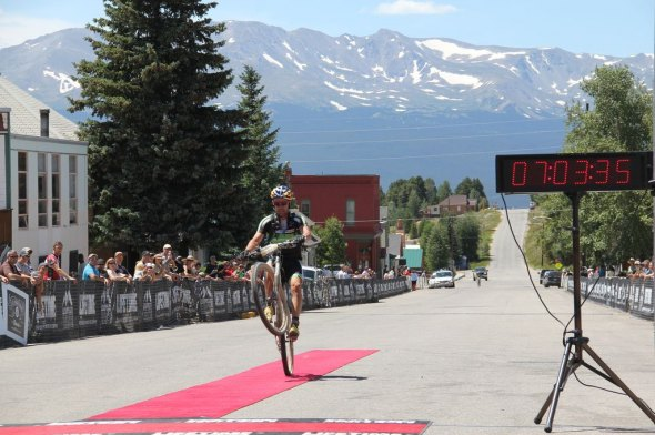 Tim Johnson crosses the line doing a wheelie at the Leadville 100. Brian Patrick - OnSight Media.