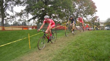 Lukas Winterberg and Lukas Muller of Philadelphia Cyclocross School surround Bad Andy Wulfkuhle (C3 Athletes Serving Athletes).