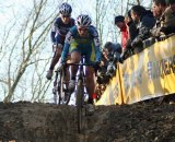 Gabby taking a muddy downhill ahead of an opponent. Photo courtesy of Gabby Day