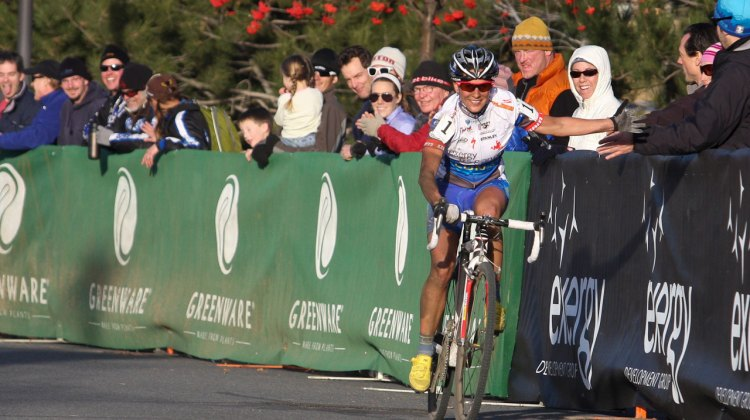 Katerina Nash celebrates her victory with fans Saturday at the Deschutes Brewery Cup in Bend. ©Pat Malach©Pat Malach