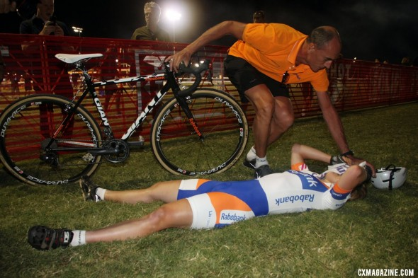 Winner Sanne van Paassen collapse after crossing the line CrossVegas 2012 finish line. ©Cyclocross Magazine