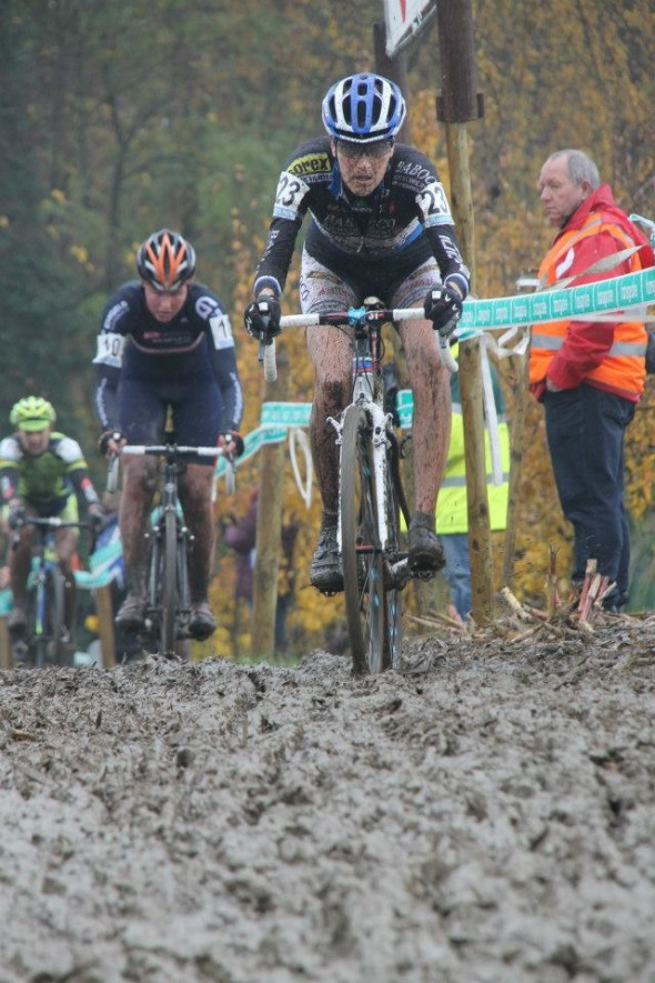 Riders head through the muck. © Bram van Lent
