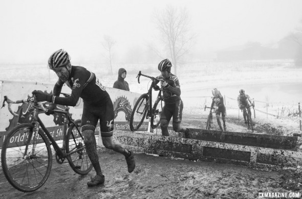 Jon Cariveau (Moots) leads Don Myrah (Ibis BuyCell) up the barriers. @ Cyclocross Magazine