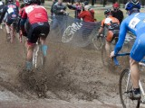A deep puddle in the starting straight woke up the Masters racers on their first lap. © Cyclocross Magazine