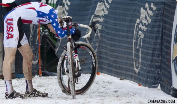 Logan Owen collapses in exhaustion, emotion, and disappointment after his fourth place finish at the 2013 Cyclocross World Championships. © Andrew Yee, Cyclocross Magazine