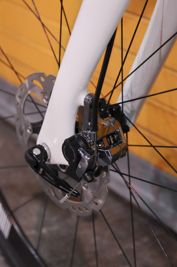 Shimano CX75 mechanical disc brakes and ENVE carbon disc fork work together to keep the Guru Sidero CX rider upright. NAHBS 2013 © Lance Barry