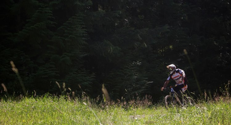 Slaven racing downhill. Photo Courtesy of the Kona Factory Team