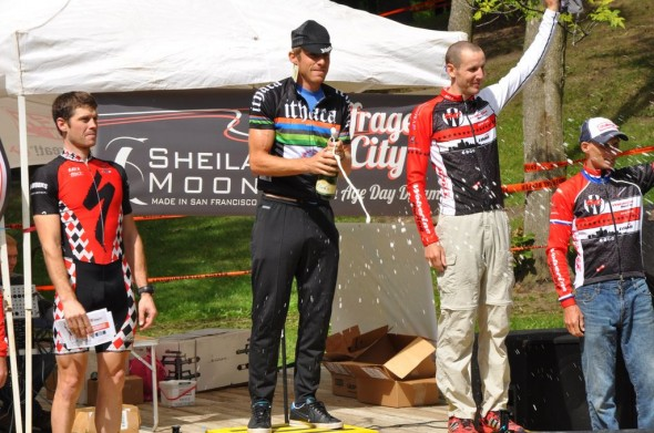 Brad White pops the champagne at last year's Ithaca GP_ he is flanked by Sven Baumann and Tom Burke (photo Curt Potocki)